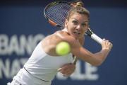 La Roumaine Simona Halep a signé une victoire... (AFP, Geoff Robins) - image 3.0