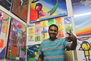 Marcos Rodrigo Neves, dit Wark, dans sa boutique... (Photo Guillaume Piedboeuf) - image 3.0