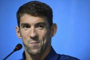 Michael Phelps portera le drapeau des États-Unis.... (AFP, Martin Bureau) - image 1.0