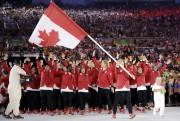 Rosannagh MacLennan menait la délégation canadienne dans le... (AP, David J. Phillip) - image 3.0