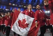 L'équipe canadienne, composée de 314 athlètes, 186 femmes... (AFP, Leon NEAL) - image 2.0