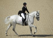 Colleen Loach et son cheval Qorry Blue d'Argouges... (Associated Press) - image 1.1