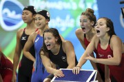 L'équipe canadienne au relais 4x200 m féminin lors... (AP, Lee Jin-man) - image 3.0