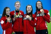 De gauche à droite, les médaillées de bronze... (PhotoDavid Gray, Reuters) - image 1.0
