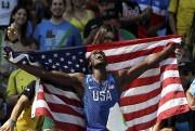 Après avoir conquis l'argent au triple saut mardi,... (AP, Matt Slocum) - image 5.0