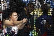 La Britannique Sophie Hitchon au lancer du marteau... (AP, Matt Dunham) - image 18.0