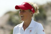 Brooke Henderson est flamboyante sur le terrain, mais... (Photo Andrew Boyers, Reuters) - image 1.0