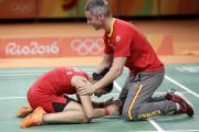 Carolina Marin et son entraîneurJavier Rivas... (AP, Kin Cheung) - image 7.0