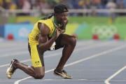 Usain Bolt a montré le chiffre «3» peint... (AP, David J. Phillip) - image 2.0