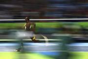 Bolt pendant l'épreuve du 4x100m.... (AFP) - image 3.0