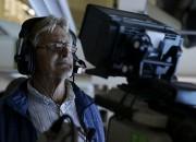 La caméraman et ancien nageur Ken Walsh, de... (AP) - image 6.0