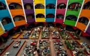 Ci-dessus: un marché à Kota Bharu en Malaisie.... (PHOTO Manan VATSYAYANA, archives Agence France-Presse) - image 1.0