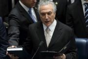 Michel Temer a prêté serment au Sénat et... (AFP, Andressa Anholete) - image 8.0