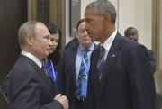 La rencontre entre les présidents russe Vladimir Poutine... (AP, Alexei Druzhinin/Sputnik) - image 2.0