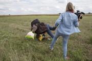 L'homme et son fils agressés par la camérawoman... (photo Marko Djurica, archives REUTERS) - image 2.0