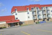 Seuls l'édifice multifonctionnel et le nouveau quartier résidentiel... (Photo Le Quotidien, Gimmy Desbiens) - image 1.0