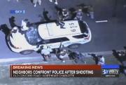 Une autopatrouille est prise d'assaut par des manifestants... (Associated Press) - image 3.0