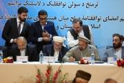 L'accord a été signé entre le Haut Conseil... (photo Rahmat Gul, AP) - image 2.0