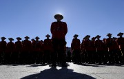 RCMP officers stand at attention at the Canadian... (Justin Tang, La Presse canadienne) - image 8.0