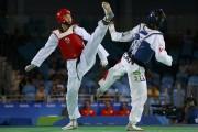 Le taekwondo comprend des coups de poing et... (Photo archives AFP) - image 4.0