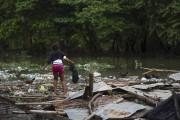 L'ouraganMatthewa causé des inondations et de nombreux dégats... (AFP, Erika Santelices) - image 3.0