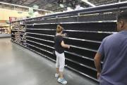 Un supermarché de Kissimmee, en Floride, a été... (AFP, Gregg Newton) - image 2.0