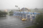 Walt Disney World a été fermé jeudi.... (AFP, Gregg Newton) - image 4.0