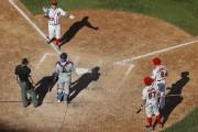 Jose Lobaton (59) célèbre après avoir frappé un... (Pablo Martinez Monsivais, Associated Press) - image 2.0