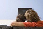 Back view of adult and child watching TV... (PHOTO THINKSTOCK) - image 4.0