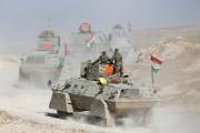 Avançant en convois de véhicules blindés à travers... (PHOTO THAIER AL-SUDANI, REUTERS) - image 2.0