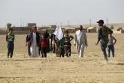 Des Irakiens du village deBajwaniyah, situé à 30... (AFP, Ahmad Al-Rubaye) - image 2.0