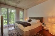 Les plafonds de béton, les planchers de bois... (Bilodeau Immobilier) - image 3.0