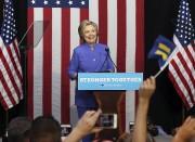 Hillary Clinton s'est engagée à proposer deux projets... (AP, Patrick Farrel) - image 9.0