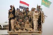 Des combattants chiites des Mobilisations populaires (Hachd al-Chaabi)... (photo  AHMAD AL-RUBAYE, archives AFP) - image 3.0