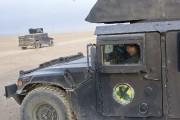 Un membre du contreterrorisme irakien au volant de... (photo Marko Drobnjakovic, archives AP) - image 5.0