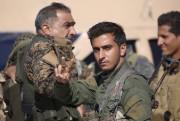 Un membre desForces démocratiques syriennes se trouvant àAïn... (AFP, Delil Souleiman) - image 2.0