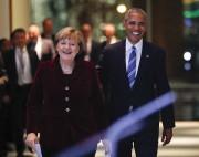 Le président Obama et Angela Merkel quittent en... (AP) - image 2.0