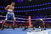 L'Américain Andre Ward, pourtant au bord du KO dès le 2e... (AFP) - image 2.0