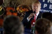 Président élu des États-Unis, Donald Trump est aussi... (AP) - image 4.0