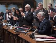 Philippe Couillard a rendu hommage aux victimes de... (Photo Jacques Boissinot, La Presse canadienne) - image 1.1