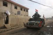 Certains Irakiens ont déployé un drapeau blanc sur... (AFP, Ahmad Al-Rubaye) - image 1.0