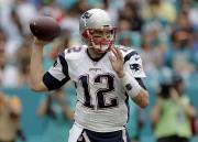 Tom Brady a amassé 276verges par la voie... (AP, Alan Diaz) - image 7.0
