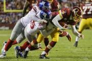 Le quart Kirk Cousins et les Redskins de... (AP, Mark Tenally) - image 9.0