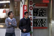 A currency board shows the US dollar exchange... (AFP) - image 9.0