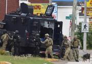 Une lourde opération policière a été menée à... (PHOTO PC) - image 2.0