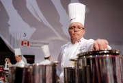 Laurent Godbout, of Canada, prepares food during the... - image 1.0