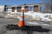 Ce cône a été enseveli sous le bitume... (Martin Roy, Le Droit) - image 4.0