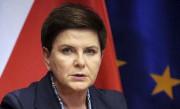 La première ministre polonaise, Beata Szydlo... (AP, Olivier Matthys) - image 2.0
