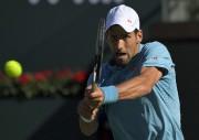 Novak Djokovic (photo) a été éliminé par Nick... (AP, Mark J. Terrill) - image 3.0