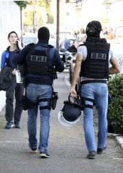 Des agents de laBrigade de recherche et d'intervention... (AP) - image 2.0